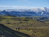 Couple Of Two Young Hikers At Laugavegur Hiking Trail With Eyjafjallajokull Volcano And Glacier Tong poster