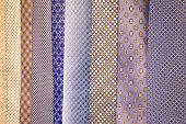 Necktie In The Closet. A Variety Of Neckties That Are Hanged In Gentlemen poster