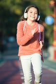 Music To Absorb Positive Energy. Energetic Small Girl Enjoy Morning Run On Autumn Landscape. Little  poster