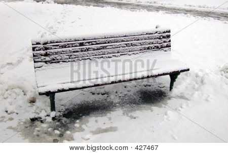 Picture or Photo of Icy bench in winter park