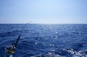 stock photo of fishing rod  - Fishing on the boat with trolling rod and reel - JPG