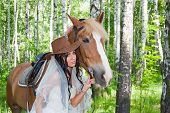 picture of birchwood  - young woman in the dress of fiancee next to a horse by a canicular day in a birchwood - JPG