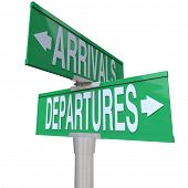 Two-way street or road signs with the words Arrivals and Departures to symbolize coming and going in