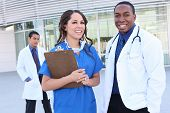 image of health-care  - A happy and successful medical team outside hospital building - JPG