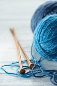 stock photo of knitting  - Knitting yarn balls in blue tone and needles - JPG