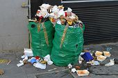 image of inappropriate  - Improperly disposed bags of litter waste and garbage - JPG