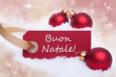 stock photo of natal  - A Red Label With the Italian Words Buon Natale Which Means Merry Christmas - JPG