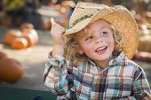 foto of riding-crop  - Adorable Little Boy Wearing Cowboy Hat at Pumpkin Patch Farm - JPG