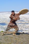 foto of chukotka  - Chukchi man in folk dress dancing a folk dance - JPG