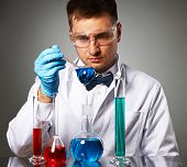 image of protective eyewear  - Scientist in protective glasses at laboratory - JPG