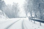 picture of icy road  - Sudden and heavy snowfall on a country road - JPG