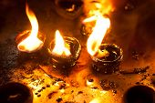 stock photo of diwali lamp  - Burning oil lamps at religious temple - JPG