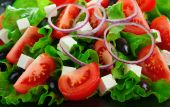 image of greek food  - Greek salad with tomatoes cheese herbs olives and onions - JPG