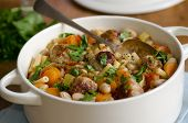 stock photo of stew pot  - White bean and pasta stew with meatballs in a pot - JPG