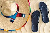 stock photo of sombrero  - Straw sombrero or sunhat with a colorful striped ribbon and slip - JPG