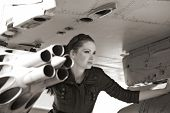 portrait of attractive woman near aircraft