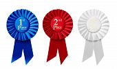 pic of rosettes  - 1st 2nd and 3rd Place pleated ribbon rosettes or badges in blue red and white respectively with central text isolated in a row on a white background overhead view - JPG