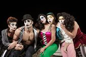 image of circus clown  - Five serious cirque clowns on theater stage - JPG