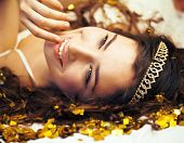 picture of tiara  - beauty young girl in gold confetti and tiara - JPG