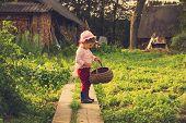 pic of cute kids  - vintage portrait of Cute kid with big basket having fun at countryside - JPG