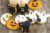 picture of halloween  - Still life with a pumpkin and halloween cookies decorated with fondant - JPG