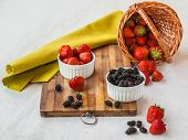 stock photo of mulberry  - Garden still life with strawberries and mulberry with a basket - JPG
