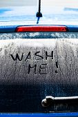 stock photo of car-window  - Wash Me Words on a Dirty Rear Car Window - JPG