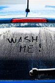 stock photo of window washing  - Wash Me Words on a Dirty Rear Car Window - JPG