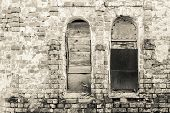 image of niche  - abstract fragment of monochrome tone of an old brick wall with window niches - JPG