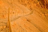 stock photo of bannister  - Fragment of a bannister on the mountain ascend to the Massada Fortress  - JPG
