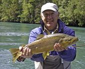 pic of trout fishing  - Big Brown Trout from the R�o Palena, Chile; caught fly fishing. ** Note: Soft Focus at 100%, best at smaller sizes - JPG