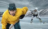 picture of ice hockey goal  - Ice hockey player on the ice in mountains - JPG