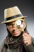 picture of private detective  - Funny detective with smoking pipe and magnifying glass - JPG