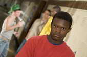 stock photo of peer-pressure  - Tough guys at school hanging around the locker - JPG