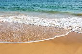 stock photo of lap  - Beautiful clear mediterranean water lapping on the shore - JPG
