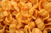 picture of twisty  - close up of bacon andpaprika flavored snacks - JPG