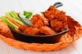 stock photo of chicken wings  - Buffalo style chicken wings and fresh vegetables - JPG