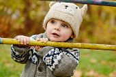 stock photo of cun  - little boy in fall time walking on the street - JPG