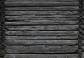 stock photo of log cabin  - Dark wooden texture of log cabin with walls to both sides - JPG