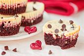 stock photo of irresistible  - Testy and irresistible Red velvet mini cheesecakes - JPG
