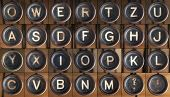 stock photo of typewriter  - Buttons from an old dusty typewriter as font - JPG