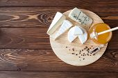 pic of brie cheese  - cheese plate with Brie Camembert Roquefort and honey - JPG
