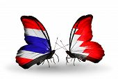 stock photo of bahrain  - Two butterflies with flags on wings as symbol of relations Thailand and Bahrain - JPG