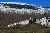 foto of snow capped mountains  - General view of village and snow capped mountains Capileira Las Alpujarras Granada Province Andalucia Spain Western Europe.