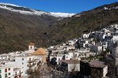 picture of snow capped mountains  - View across white village towards the snow capped mountains of the Sierra Nevada Pampaneira Las Alpujarras Granada Province Andalusia Spain Western Europe - JPG