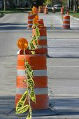 image of road construction  - line of road construction barrels - JPG