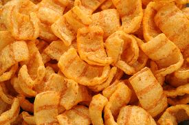 stock photo of twisty  - close up of bacon andpaprika flavored snacks - JPG