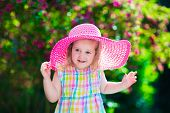 pic of birthday hat  - Little cute girl with flowers - JPG