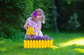 picture of little young child children girl toddler  - Child working in the garden - JPG