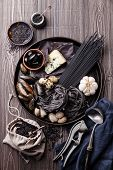 image of clam  - Black raw food ingredients  - JPG